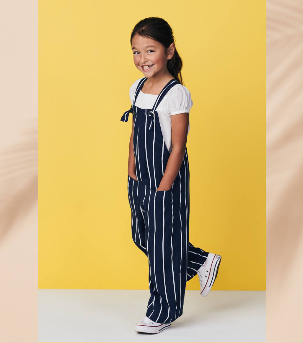 Young girl wearing striped overalls
