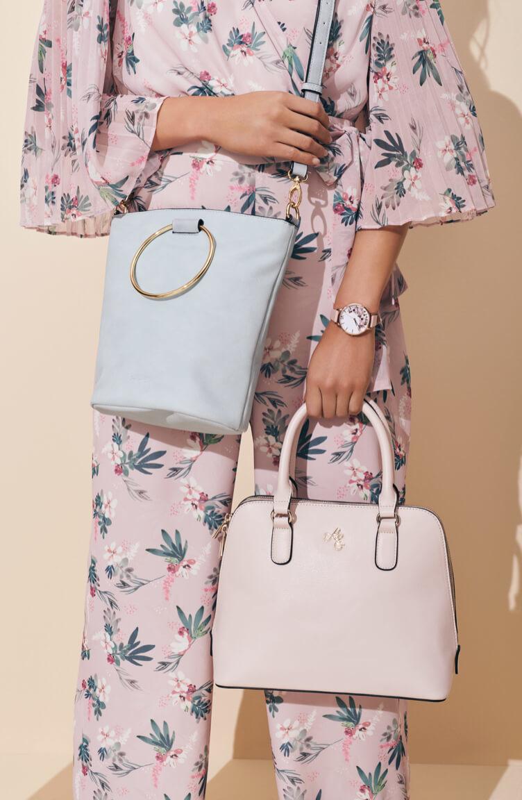 Woman holding pastel handbags