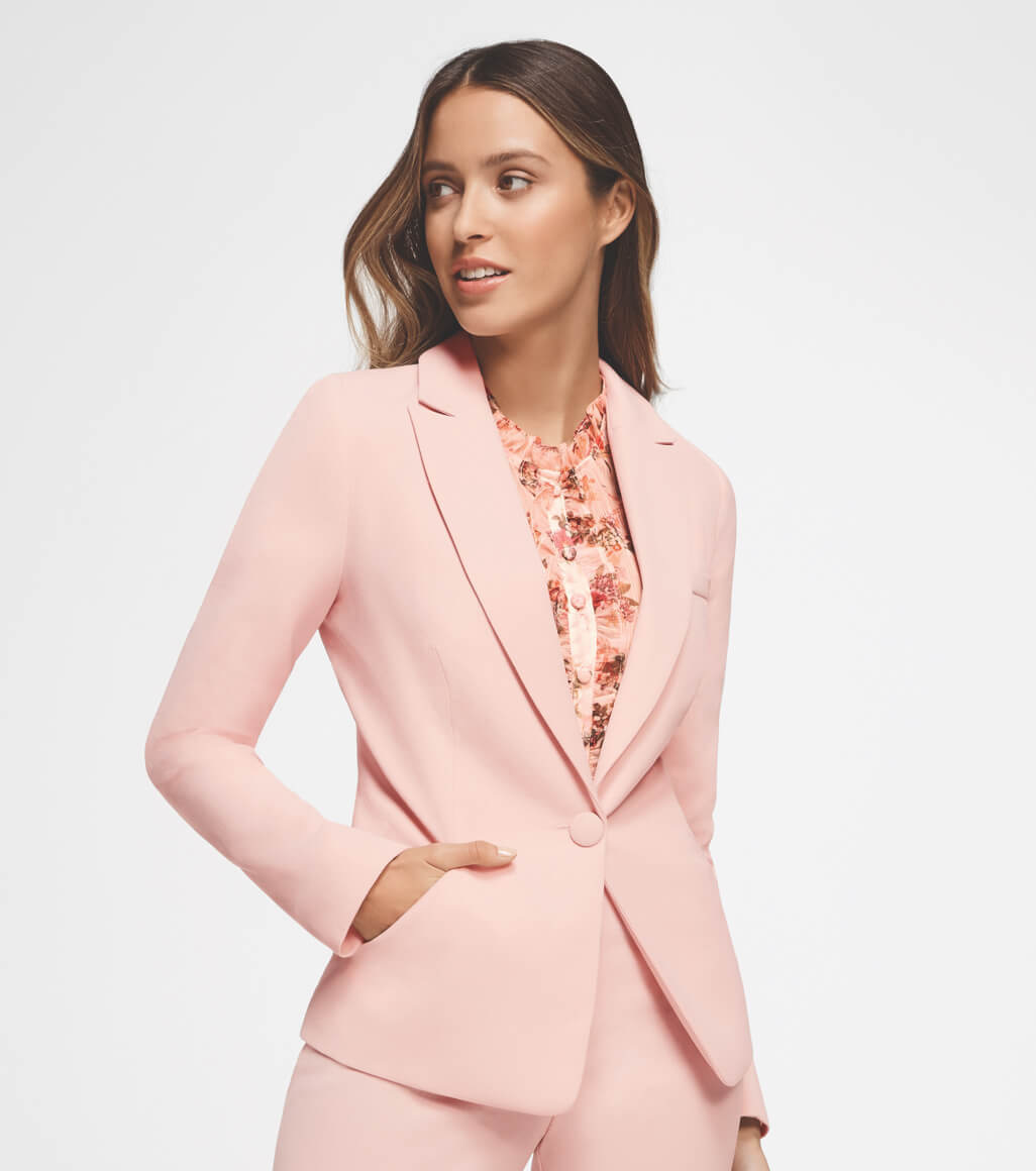 Woman wearing pink suit