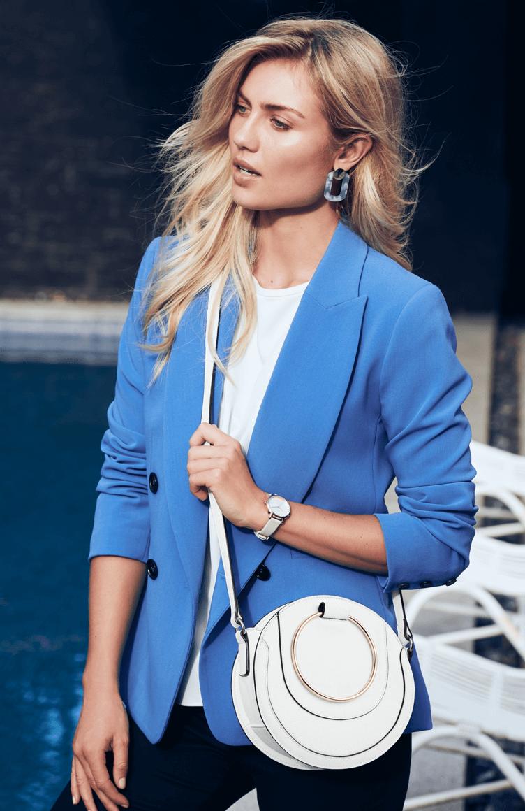 Woman wearing light blue blazer
